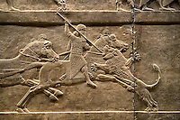 Assyrian relief sculpture panel of Ashurnasirpal lion hunting.  From Nineveh  North Palace, Iraq,  668-627 B.C.  British Museum Assyrian  Archaeological exhibit no ME 124876.