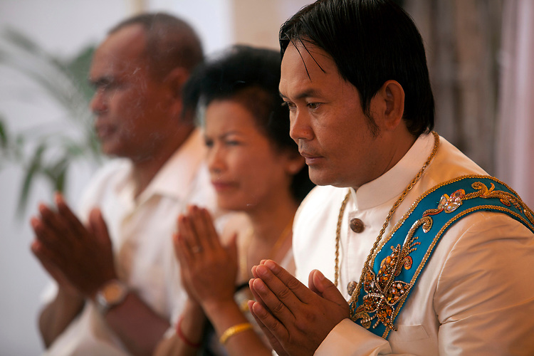 Groom at a buddhist wedding in a small village outside of Phnom Penh, Cambodia. <br /> <br /> Photos &copy; Dennis Drenner 2013.