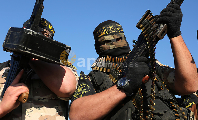 Palestinian militants from the Al-Quds Brigades, the armed wing of the Islamic Jihad movement, take part in a military parade, in Khan younis in the southern Gaza strip, on March 4, 2017. Photo by Ashraf Amra