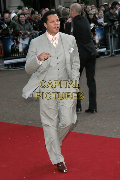 "TERRENCE HOWARD.UK Premiere of ""Iron Man"" at the Odeon, Leicester Square, London, England. .April 24th 2008.full length grey gray suit waistcoat hand in pocket walking mouth open hand pointing .CAP/AH.©Adam Houghton/Capital Pictures."