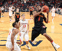Jan. 27, 2011; Charlottesville, VA, USA; Maryland Terrapins guard Adrian Bowie (1) shoots next to Virginia Cavaliers guard Jontel Evans (1) and Virginia Cavaliers guard Sammy Zeglinski (13) during the game at the John Paul Jones Arena. Maryland won 66-42. Mandatory Credit: Andrew Shurtleff
