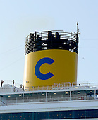 The smokestack of the Costa Fascinosa, a Concordia-class cruise ship, as it sails through the harbor in Venice, Italy on April 14, 2013.  It was constructed by Fincantieri's Marghera shipyard in Venice, Italy.  Its maiden voyage began on May 6, 2012. It can carry up to 3,780 passengers in 1,506 cabins..Credit: Ron Sachs / CNP