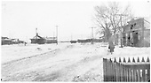 Snowy view of Antonito looking south to the depot and freight house.<br /> D&amp;RG  Antonito, CO  Taken by Joyce, W. D. - 1910-1920