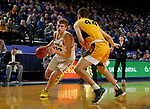 BROOKINGS, SD - JANUARY 22: Matt Dentlinger #32 of the South Dakota State Jackrabbits drives to the basket against Tyler Witz #44 of the North Dakota State Bison at Frost Arena on January 22, 2020 in Brookings, South Dakota. (Photo by Dave Eggen/Inertia)