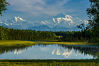 Summer landscape of the southside view of Denali (aka Mt. Mckinley) and the Alaska Range in the early morning hours of summer. Reflection in lake.  Southcentral, Alaska<br /> <br /> Photo by Jeff Schultz/SchultzPhoto.com  (C) 2016  ALL RIGHTS RESVERVED
