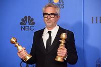 After winning the Golden Globes for BEST MOTION PICTURE &ndash; FOREIGN LANGUAGE and BEST DIRECTOR &ndash; MOTION PICTURE for &ldquo;Roma&rdquo; (MEXICO), Alfonso Curaon poses with the awards backstage in the press room at the 76th Annual Golden Globe Awards at the Beverly Hilton in Beverly Hills, CA on Sunday, January 6, 2019.<br /> *Editorial Use Only*<br /> CAP/PLF/HFPA<br /> Image supplied by Capital Pictures