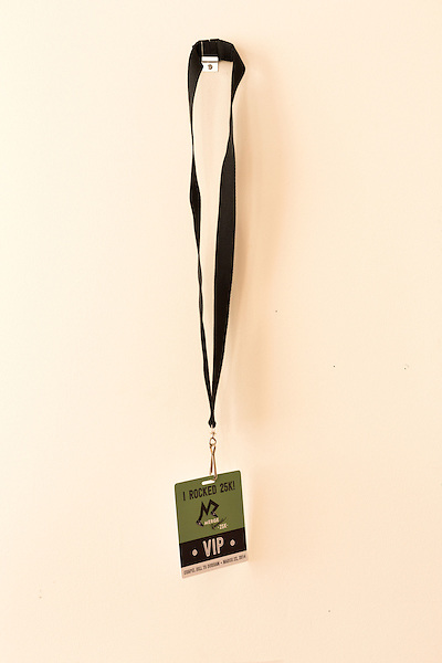 March 20, 2014. Durham, North Carolina.<br />   A lanyard for the 25ht anniversary road race hangs on the wall MERGE HQ in downtown Durham. To celebrate their upcoming 25th anniversary, MERGE Records hosted a 25k race from Chapel Hill, where the label originated, to their new home in Durham. 693 people race the 15 mile course and celebrated at the after party in the streets.