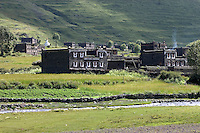 Traditional Tibetan style stone houses & river in the highlands of Kham - Sichuan Province, China, (Tibet)