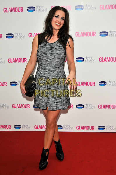 KIRSTY GALLACHER .Glamour Women Of The Year Awards - Inside Arrivals, Berkeley Square Gardens, London, England, UK, .June 8th 2010..full length sleeveless grey gray tweed wool patterned dress black clutch bag ankle boots pleated .CAP/PL.©Phil Loftus/Capital Pictures.