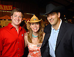 Jacob Stein, Allison Hawkins and Adam Flikerski at the annual Cattle Barron's Ball at the George Ranch Saturday April 25,2009.(Dave Rossman/For the Chronicle)