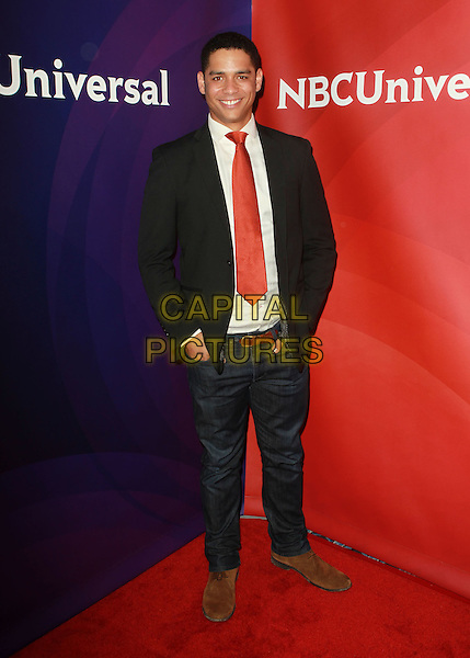 Charlie Barnett.NBC Universal Press Tour Held At The Beverly Hilton Hotel, Los Angeles, California, USA..July 24th, 2012.full length black suit jacket white shirt red tie jeans denim .CAP/ADM/FS.©Faye Sadou/AdMedia/Capital Pictures.