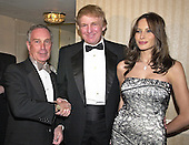 Mayor Michael Bloomberg (Republican of New York) welcomes Donald Trump and Melania Knauss to his hospitality suite prior to the White House Correspondents Association Dinner at the Washington Hilton Hotel in Washington, DC on April 28, 2001.<br /> Credit: Ron Sachs / CNP