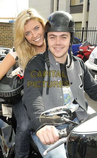 EMMA STEPHENS & RAY QUINN.The Charity Bike Ride 2010, Warr's Harley Davidson Dealership, King's Road, London, England..August 8th, 2010.half length sitting motorcycle motorbike trike helmet black grey gray jacket jeans denim white cream top.CAP/CAN.©Can Nguyen/Capital Pictures.