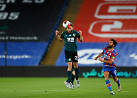 29th June 2020; Selhurst Park, London, England; English Premier League Football, Crystal Palace versus Burnley Football Club; Erik Pieters of Burnley beats Andros Townsend of Crystal Palace to head the ball clear