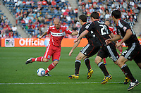 Chicago midfielder Freddie Ljungberg (8) maneuvers to evade a line of DC United players.  The Chicago Fire tied DC United 0-0 at Toyota Park in Bridgeview, IL on Oct. 16, 2010.