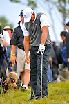 28 August 2009: Tiger Woods reacts to his shot out of the rough during the second round of The Barclays PGA Playoffs at Liberty National Golf Course in Jersey City, New Jersey.