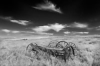 Old  farm equipment on abandonned farm , Near Monchy, Saskatchewan, Canada