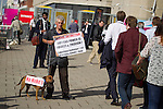 © Joel Goodman - 07973 332324 . No syndication permitted . 24/09/2013 . Brighton , UK . Protester STUART HOLMES , who was tackled to the ground with his dog (also called Stuart) this morning (24th September 2013) by blogger Iain Dale . Day 3 of the 2013 Labour Party Conference in Brighton . Photo credit : Joel Goodman