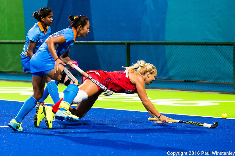 Kelsey Kolojejchick #7 of United States dives in an attempt to keep the ball in play during USA vs India in a women's Pool B game at the Rio 2016 Olympics at the Olympic Hockey Centre in Rio de Janeiro, Brazil.