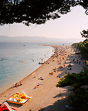 CROATIA, Bol, Brac, Dalmatian Coast, Island, high angle view of people relaxing in Zlatni Rat Beach.