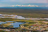 Aerial of the Tanana river and the edge of the city of Fairbanks, situated along the Tanana Valley Flats. The prominent peak of mount Hayes of Alaska Range along the distant horizon, Fairbanks, Alaska.