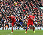 Diego Costa of Chelsea attempts an overhead kick between Alberto Moreno and Dejan Lovren of Liverpool  - Barclays Premier League - Liverpool vs Chelsea - Anfield Stadium - Liverpool - England - 8th November 2014  - Picture Simon Bellis/Sportimage