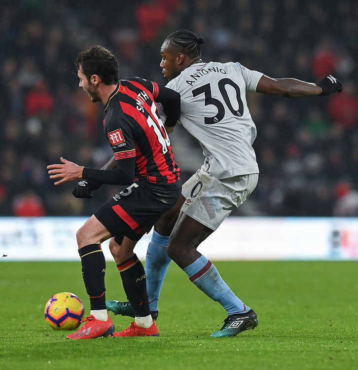 West Ham United's Michail Antonio (right) battles with Bournemouth's Adam Smith (left) <br /> <br /> Photographer David Horton/CameraSport<br /> <br /> The Premier League - Bournemouth v West Ham United - Saturday 19 January 2019 - Vitality Stadium - Bournemouth<br /> <br /> World Copyright © 2019 CameraSport. All rights reserved. 43 Linden Ave. Countesthorpe. Leicester. England. LE8 5PG - Tel: +44 (0) 116 277 4147 - admin@camerasport.com - www.camerasport.com