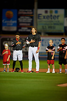 Reading Fightin Phils Jose Antequera (left) and Alec Bohm (right) during the national anthem with young fans before an Eastern League game against the Trenton Thunder on August 16, 2019 at FirstEnergy Stadium in Reading, Pennsylvania.  Trenton defeated Reading 7-5.  (Mike Janes/Four Seam Images)