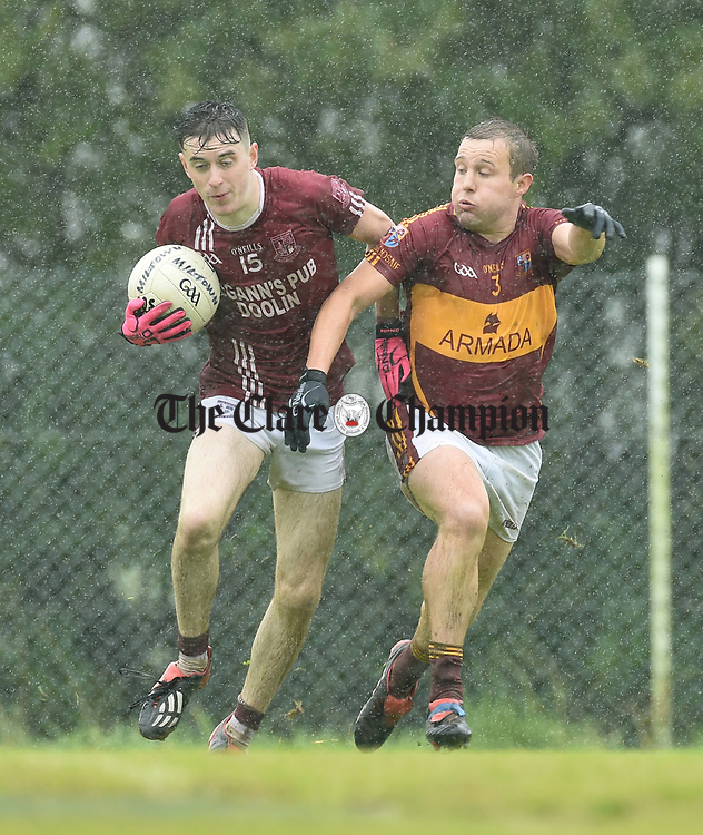 Joe Mc Gann of St Breckan's in action against Seanie Malone of St Joseph's Miltown Malbay during their first round senior championship game in Ennistymon. Photograph by John Kelly