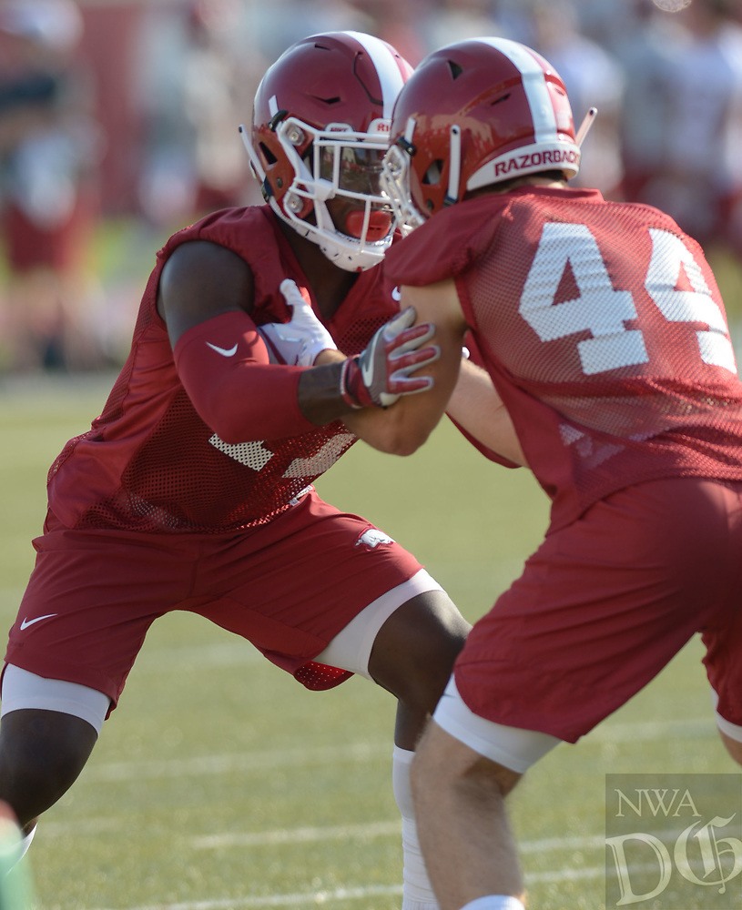 NWA Democrat-Gazette/ANDY SHUPE<br /> Arkansas defensive back Joseph Foucha (left) works through a drill with Dameron Vail Friday, Aug. 3, 2018, during practice at the university practice field on campus in Fayetteville. Visit nwadg.com/photos to see more photographs from the practice.