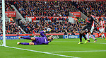 Stoke City goalkeeper Jack Butland saves from Danny Welbeck of Arsenal during the premier league match at the Britannia Stadium, Stoke. Picture date 19th August 2017. Picture credit should read: Robin Parker/Sportimage