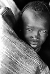 A Turkana boy waits for food during a famine relief operation on the edge of the Suguta Valley.<br /> <br /> Northern Kenya.