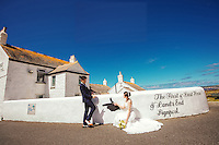 A Chinese couple pose for their wedding photos at Lands End, Cornwall.  An increasing number of Chinese couple are having their wedding photos taken in the English country-side, classic towns and monuments to show in China.