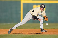 Third baseman Shane Kroker #10 of the Wake Forest Demon Deacons tracks a ground ball at English Field March 27, 2010, in Blacksburg, Virginia.  Photo by Brian Westerholt / Four Seam Images