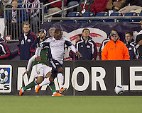 New England Revolution forward Sainey Nyassi (17) comes away with the ball. In a Major League Soccer (MLS) match, the New England Revolution tied the Portland Timbers, 1-1, at Gillette Stadium on April 2, 2011.