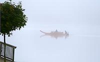 Austria; Styria; Styrian Salzkammergut; Ausseer Land, boat on Grundl Lake in early morning fog in autumn | Oesterreich, Steiermark, Steirisches Salzkammergut, Ausseer Land, Zillenfahrt auf dem Grundlsee im herbstlichen Morgennebel