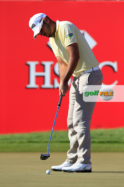 Gregory Havret (FRA) takes his putt on the 18th green during Friday's Round 2 of the Abu Dhabi HSBC Golf Championship at Abu Dhabi Golf Club, 18th January 2013 (Photo Eoin Clarke/www.golffile.ie)