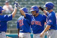 Iowa Cubs catcher Max Ramirez (20) is greeted by his teammates following his HR against the Round Rock Express on April 10th, 2011 at Dell Diamond in Round Rock, Texas.  (Photo by Andrew Woolley / Four Seam Images)