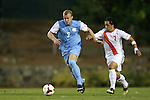 18 October 2013: North Carolina's Josh Rice (left) and Syracuse's Alex Halis (CAN) (right). The University of North Carolina Tar Heels hosted the Syracuse University Orangemen at Fetzer Field in Chapel Hill, NC in a 2013 NCAA Division I Men's Soccer match. UNC won the game 1-0.