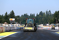 Aug. 3, 2014; Kent, WA, USA; NHRA safety safari tractor does track prep prior to the Northwest Nationals at Pacific Raceways. Mandatory Credit: Mark J. Rebilas-s