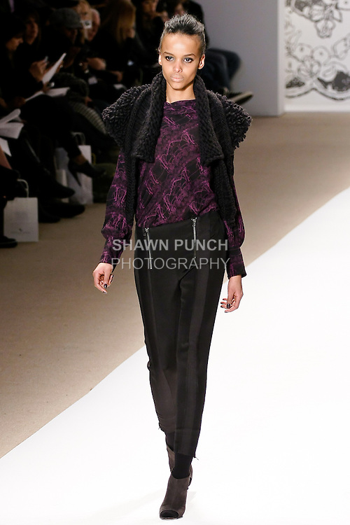 Cici Ali walks the runway in a Hansel and Gretel mock neck long sleeved blouse with buttoned back in mulberry/black, chunky knit shawl in black, and lepard jacquard double exposed zipper pant in black, by Wenlan Chia, for the Twinkle By Welan Fall 2010 fashion show, during Mercedes-Benz Fashion Week Fall 2010.