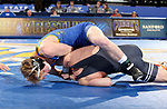 BROOKINGS, SD - NOVEMBER 17: Henry Pohlmeyer from South Dakota State University tries to roll Boo Lewallen from Oklahoma State University to his back during their 149 pound match Saturday night at Frost Arena in Brookings. (Photo by Dave Eggen/Inertia)