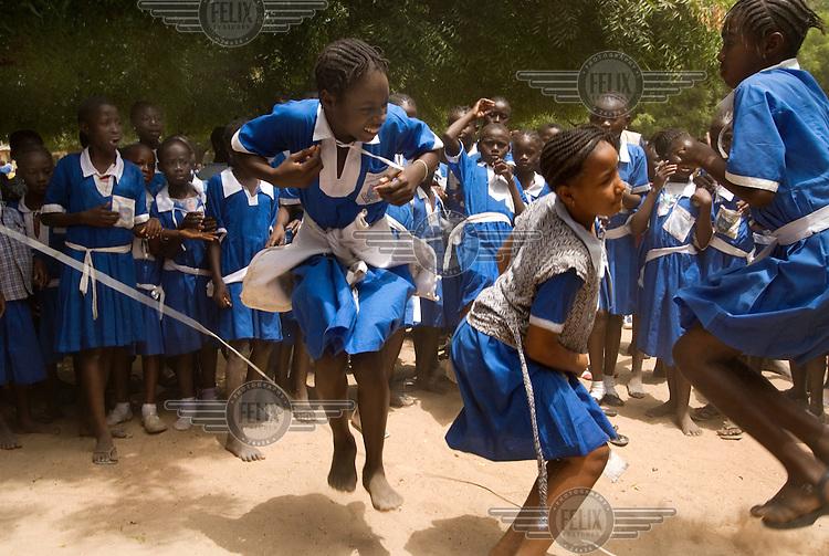 Kids at the St Charles Lwanga school play during their break.