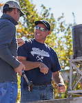 Craig Lemmons, right, competes in the single jack rock drilling contest during the Nevada Day activities in Carson City on Saturday, October 29, 2016.