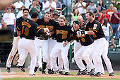 August 11th 2008:  Sergio Santos (19) comes to home plate after hitting a game ending walk off home run in the bottom of the 9th inning.  Waiting at home are Anderson Machado (38), Brock Peterson (17), Luke Hughes (18), Howie Clark (12), Trevor Plouffe (9), Anthony Swarzak (37) and Jason Pridie (11),  during a game at Frontier Field in Rochester, NY.  Photo by:  Mike Janes/Four Seam Images