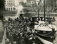 BNPS.co.uk (01202 558833)<br /> Pic: Sport&GeneralPressAgency/RNLI<br /> <br /> Lifeboat Day Centenary in Trafalgar Square, 1924 - Special permission were given for lifeboats to be stationed in public places - the day raised £5,675<br /> <br /> Splash in the Attic...<br /> <br /> A 'lost' cache of 13,000 photographs charting the history of the RNLI has been found in the attic of the charity's headquarters.<br /> <br /> Many of the black and white photos date back to the 1920s and '30s long before the terms 'health and safety' and 'risk assessment' were thought of.<br /> <br /> One image depicts a brave lifeboatman dressed in a suit and cloth cap just as the lifeboat he is on launches down a ramp into a choppy sea.<br /> <br /> Another shows the crew of another open lifeboat getting swamped by waves with only their souwesters and lifejackets to protect them.<br /> <br /> The photos have been unearthed in storage space at the RNLI HQ in Poole, Dorset, and they are now being digitised.