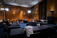 A hearing room is seen almost empty after the United States Senate HELP committee hearing at the United States Capitol in Washington D.C., U.S., was moved online on Wednesday, June 10, 2020.  Credit: Stefani Reynolds / CNP/AdMedia