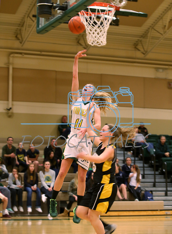 Manogue's Brianna Holt goes for a lay-up against Galena at Manogue High School in Reno, Nev., on Tuesday, Feb. 11, 2014. Manogue won 51-29.<br /> Photo by Cathleen Allison