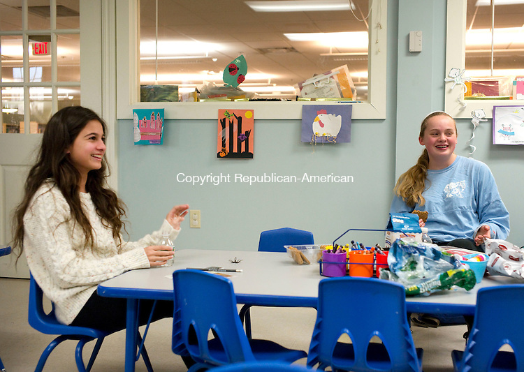 """Southbury, CT- 07 January 2016-010716CM02-  Erin Farrell, 13, left, and  Caroline DePalma,14, both of Southbury talk about """"The Secret Files of Fairday Morrow"""" which was written by Pomperaug High School graduates, Jessica Haight and Stephanie Robinson during a book talk at the Southbury Public Library on Thursday.  The group was talking about the book, part of a series at the library.  """"It was really good."""" said DePalma.     Christopher Massa Republican-American"""