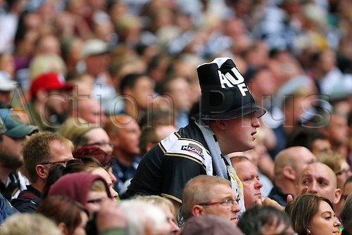 24.08.2013 London, England. Hull FC supporters cheer for their team during the Tetley's Challenge Cup Final between Hull FC and Wigan Warriors from Wembley Stadium
